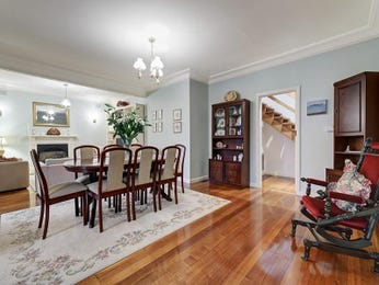 Classic dining room idea with floorboards & staircase - Dining Room Photo 2387733