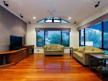 Open plan living room using black colours with floorboards & bay windows - Living Area photo 1218531
