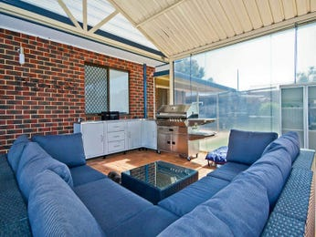 Open plan living room using blue colours with exposed brick & built-in shelving - Living Area photo 766541