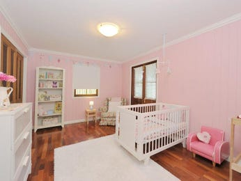 Children's room bedroom design idea with floorboards & built-in desk using pink colours - Bedroom photo 1294017