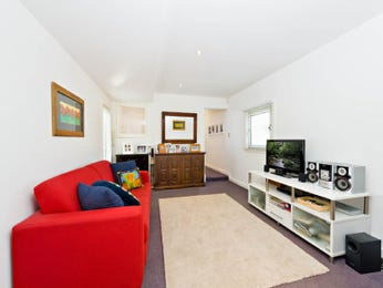 Dining-living living room using beige colours with carpet & built-in shelving - Living Area photo 1552392