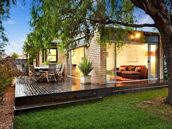 Indoor-outdoor outdoor living design with deck & latticework fence using grass - Outdoor Living Photo 707609