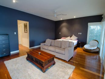 Open plan living room using blue colours with floorboards & louvre windows - Living Area photo 772338