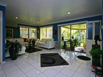 Open plan living room using blue colours with carpet & bay windows - Living Area photo 433578