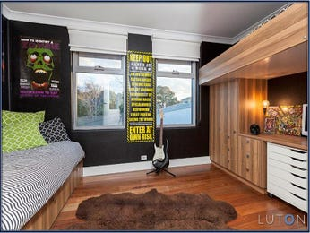 Modern bedroom design idea with floorboards & built-in desk using black colours - Bedroom photo 1522833