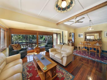 Dining-living living room using beige colours with floorboards & bi-fold doors - Living Area photo 1318837