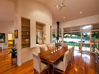Classic dining room idea with floorboards & fireplace - Dining Room Photo 862754