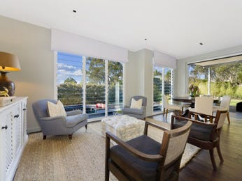 Open plan living room using beige colours with hardwood & floor-to-ceiling windows - Living Area photo 1601710