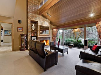 Open plan living room using brown colours with hardwood & built-in shelving - Living Area photo 301337