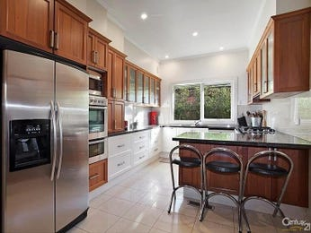 Wood panelling in a kitchen design from an Australian home - Kitchen Photo 15618781