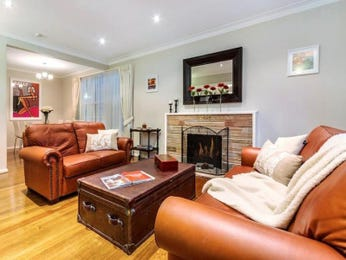 Open plan living room using orange colours with leather & fireplace - Living Area photo 7290445