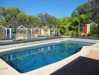 In-ground pool design using pavers with decking & shade sail - Pool photo 775354