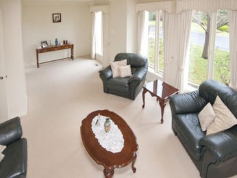 Split-level living room using white colours with carpet & bi-fold doors - Living Area photo 1518832