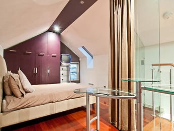 Modern bedroom design idea with floorboards & built-in wardrobe using brown colours - Bedroom photo 1235287