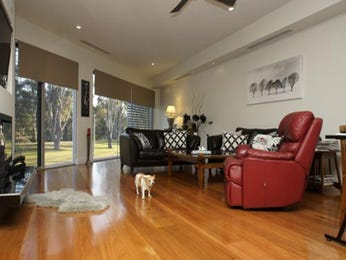 Open plan living room using black colours with floorboards & louvre windows - Living Area photo 907949