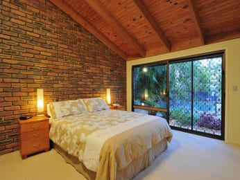 Classic bedroom design idea with floorboards & bi-fold doors using cream colours - Bedroom photo 303056