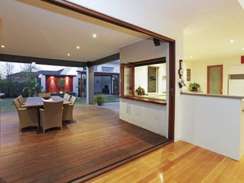 Indoor-outdoor outdoor living design with balcony & decorative lighting using brick - Outdoor Living Photo 1245104