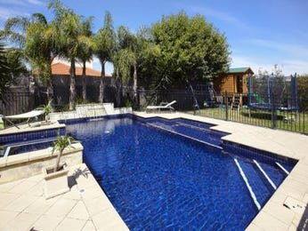 Geometric pool design using tiles with pool fence & outdoor furniture setting - Pool photo 995175