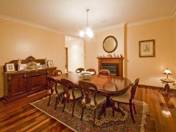 Classic dining room idea with floorboards & fireplace - Dining Room Photo 595275