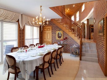 Classic dining room idea with exposed brick & staircase - Dining Room Photo 8322209