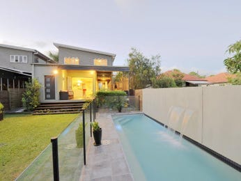 Walled outdoor living design with glass balustrade & fountain using stone - Outdoor Living Photo 1147288