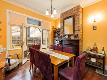 Classic dining room idea with exposed brick & fireplace - Dining Room Photo 8853973