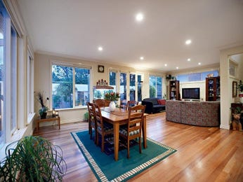 Casual dining room idea with laminate & bi-fold doors - Dining Room Photo 438208