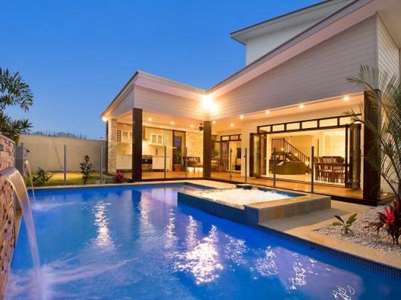 geometric pool design using tiles with cabana waterfall pool photo