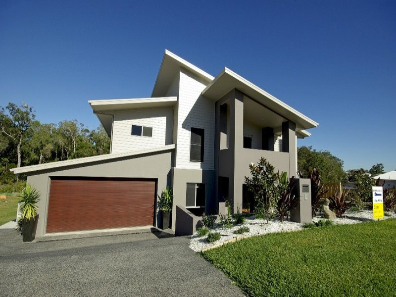 Weatherboard modern house exterior with balcony rockery for Weatherboard house designs