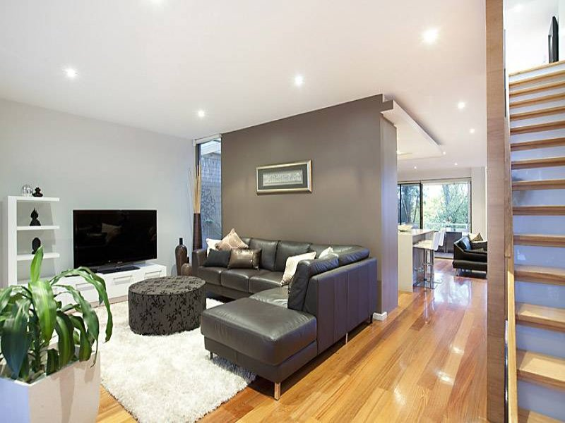 Brown living room idea from a real australian home for Living area interior