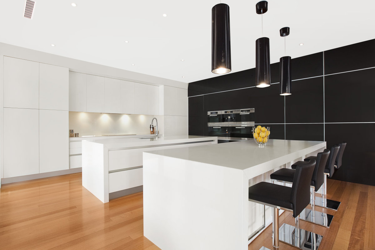 Modern island kitchen design using floorboards kitchen for Modern black and white kitchen designs