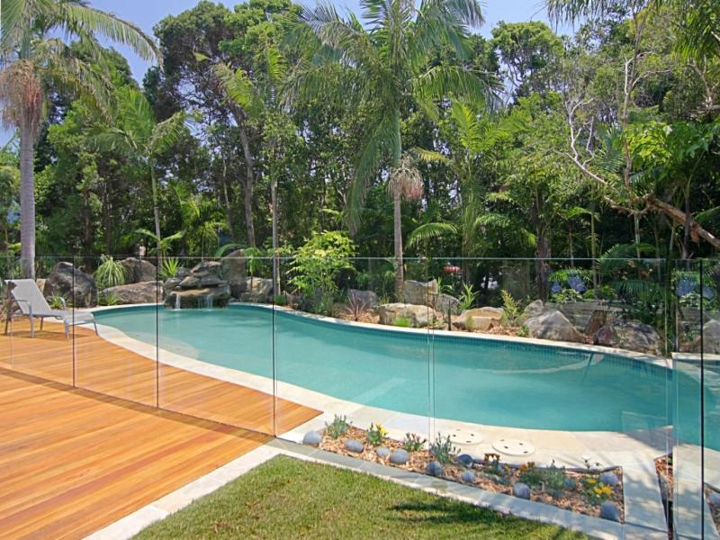 landscaped pool design using natural stone with bbq area
