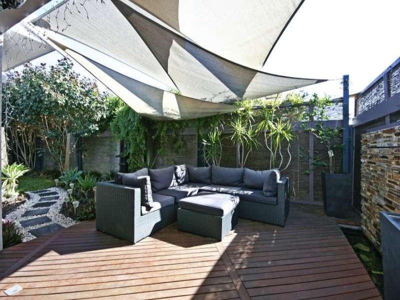 landscaped garden design using pavers with deck  u0026 ground lighting