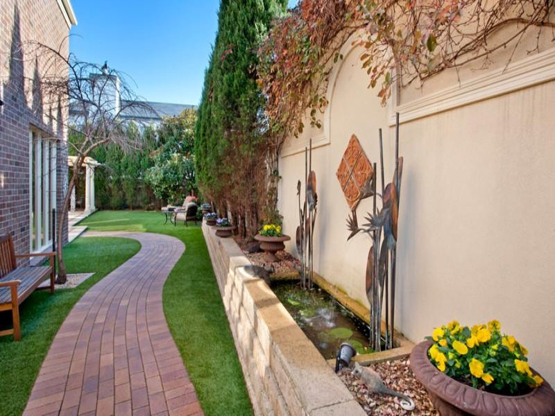 Landscaped garden design using brick with retaining wall ...