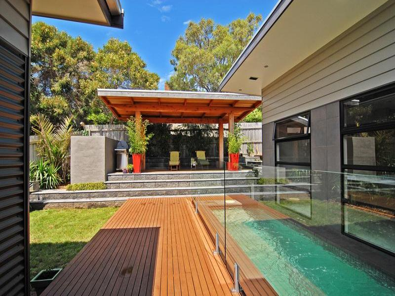array inground pool design using grass with bbq area outdoor furniture