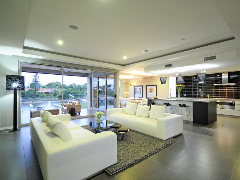Open plan living room using grey colours with tiles Flooring for living room and living areas
