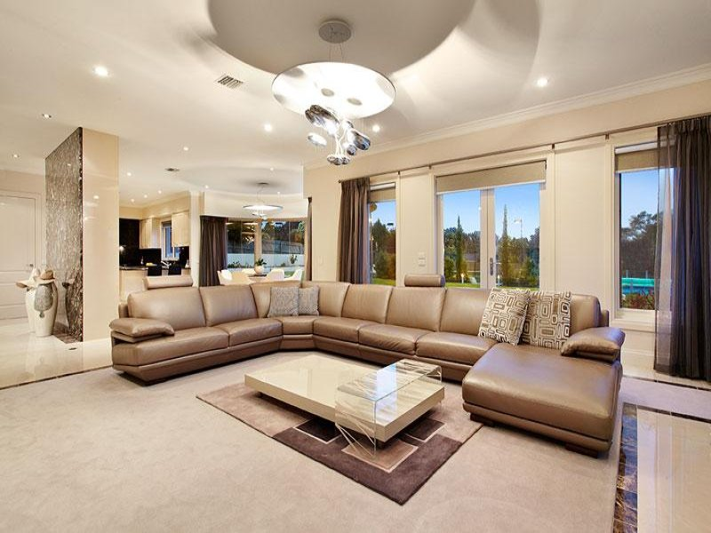 splitlevel living room using beige colours with carpet