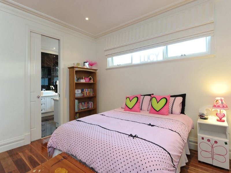 Children's room bedroom design idea with floorboards & sliding doors using pink colours - Bedroom photo 167898