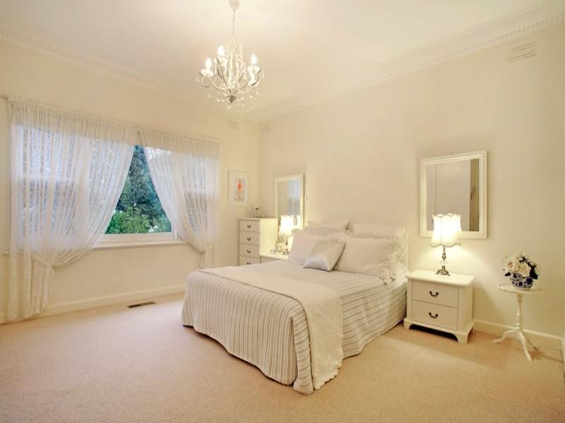modern bedroom design idea with carpet french doors using cream