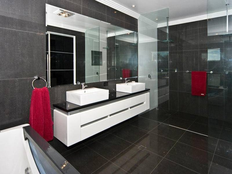 modern bathroom design with built in shelving using frameless glass
