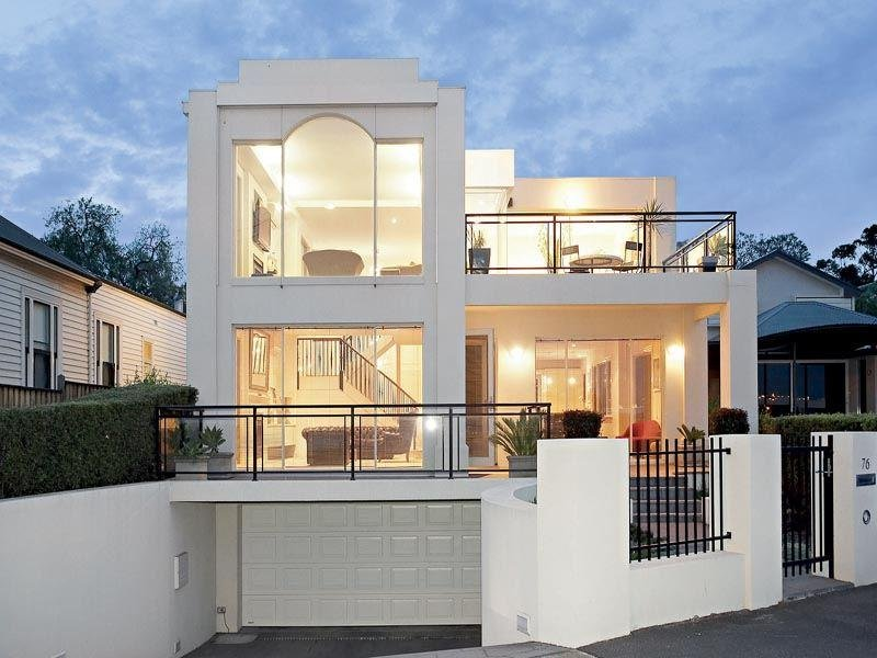 Glass modern house exterior with balcony hedging house for Modern house design with balcony