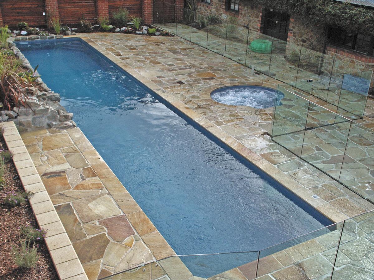 endless pool design using pavers with glass balustrade  u0026 rockery