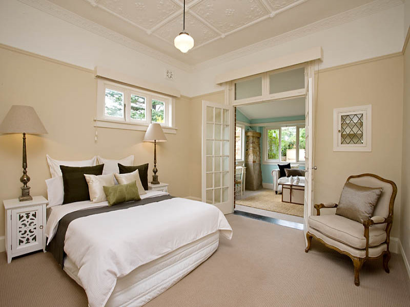 modern bedroom design idea with carpet bi fold doors using cream