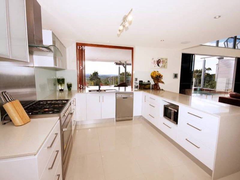 Modern open plan kitchen design using stainless steel Contemporary open plan kitchen