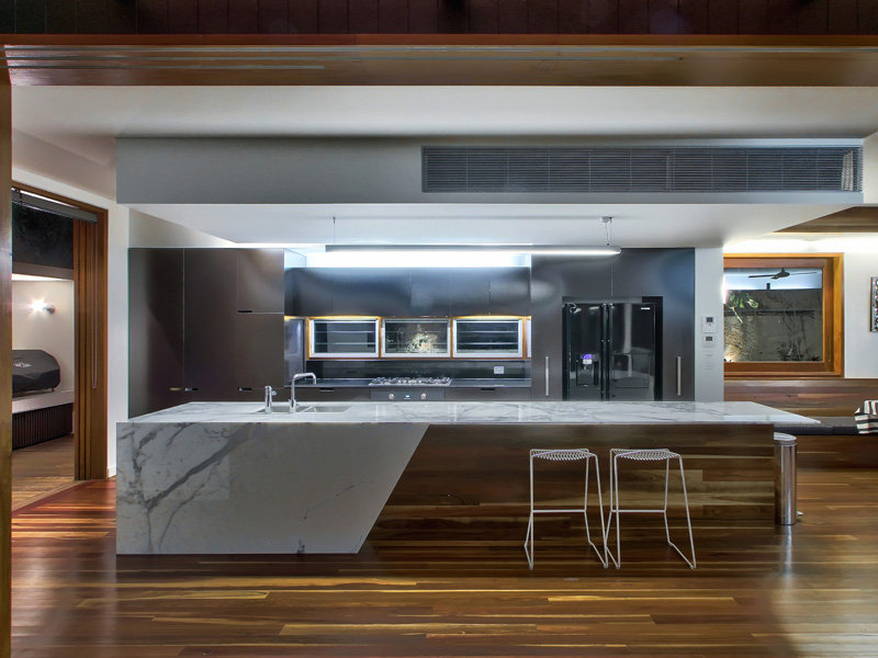 Modern galley kitchen design using floorboards kitchen for Latest kitchen island designs