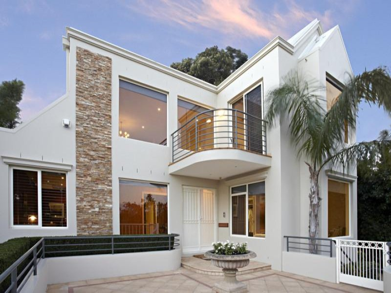 Photo of a tiles house exterior from real australian home for Brick and stone house facades