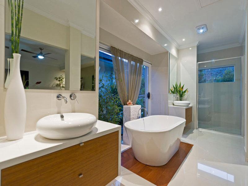 Modern bathroom design with floor to ceiling windows using for New bathroom floor ideas