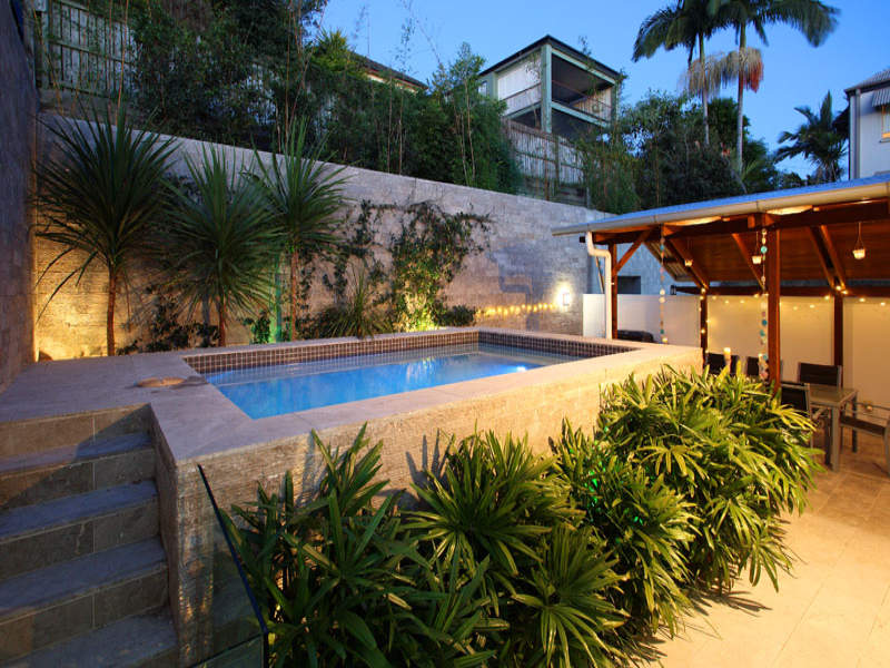 in-ground pool design using pavers with gazebo  u0026 decorative lighting