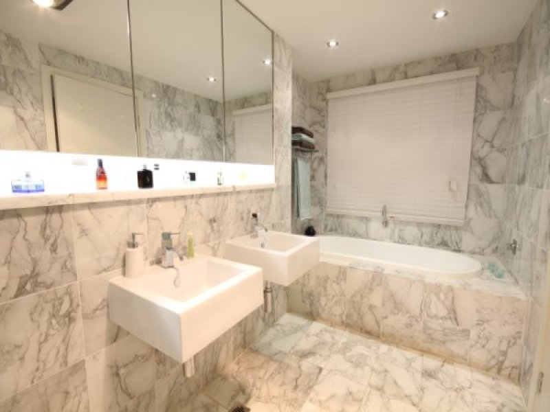 Modern Bathroom Design With Recessed Bath Using Marble
