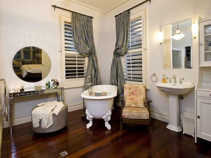 classic bathroom design with claw foot bath using ceramic